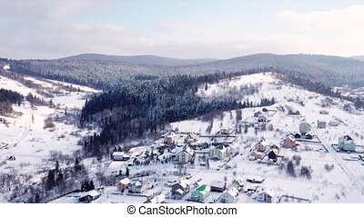 Village with the buildings is all covered with snow. Aerial view