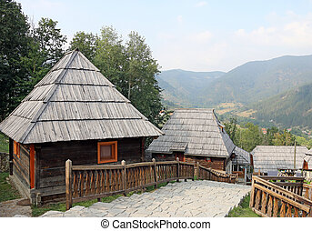 village with wooden cabin log on mountain