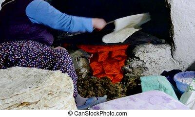 village women making yufka bread in tandoor, yufka bread in central Anatolia,