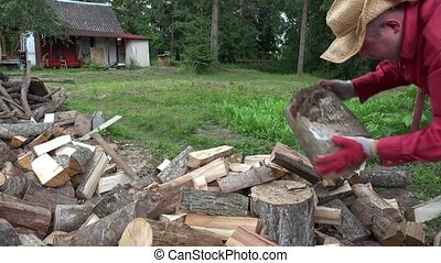 Village worker man chop wood with axe. 4K - Village worker...