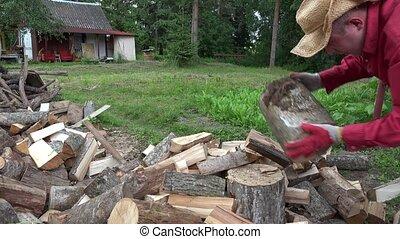Village worker man chop wood with axe. 4K - Village worker...