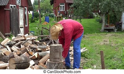 Villager guy with hat unsuccessful try to chop big wood log. 4K