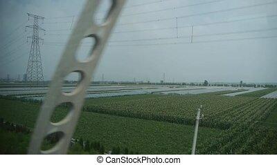 Villages plains tree crops farmland in rural countryside.Speeding train travel,