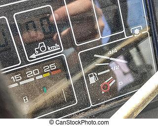 VILLANOVA DEL GHEBBO, ITALY 7 MAY 2020: Tractor dashboard fuel level