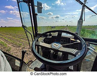 VILLANOVA DEL GHEBBO, ITALY 7 MAY 2020: Tractor dashboard in field