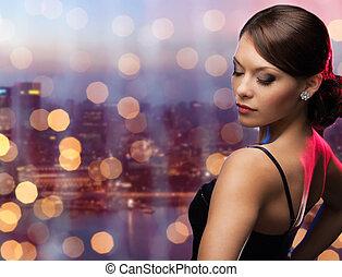 ville, diamant, sur, boucle oreille, femme, nuit