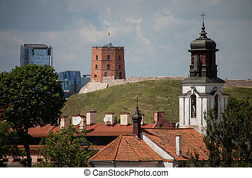 Vilnius old town cityscape with Gediminas castle and modern office buildings, Lithuania