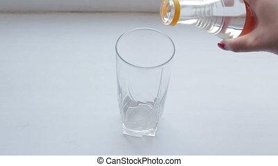 Vinegar and baking soda sparkling water glass on  white background