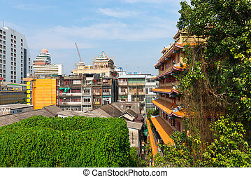 Vines Climb on a Chinese Temple in Urban Bangkok