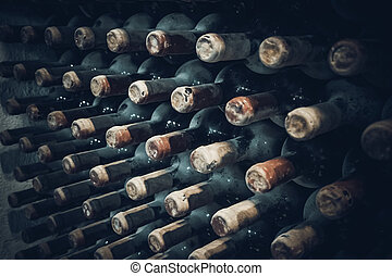 vineyard cellar with old bottles. Wine bottles from cellar -...