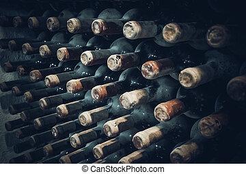 vineyard cellar with old bottles. Wine bottles from cellar -...