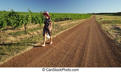 Vineyard winery lady - Blonde lady walking in Vineyard...
