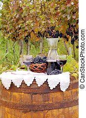 vineyard with grape and red wine