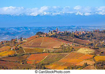Vineyards and hills in autumn in Italy. - Small town on the ...