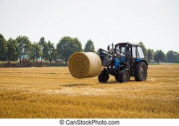 Vinnitsa, Ukraine - July 26,2016.huge tractor collecting ...