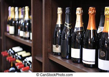 vino espumoso, y, botellas de champán, en, un, licorería