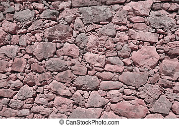vinous old wall made of big and little stones - vinous old...