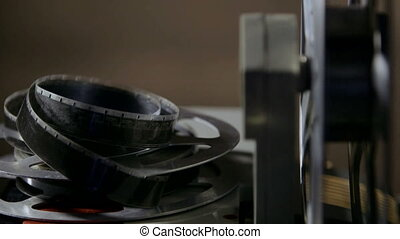 Vintage 16 mm movie projector and film reel closeup