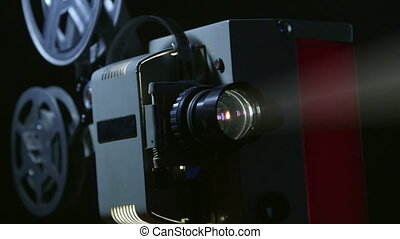 Vintage 16 mm movie projector in action close up