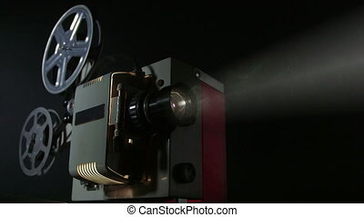16 mm movie projector projecting film - Vintage 16 mm movie...
