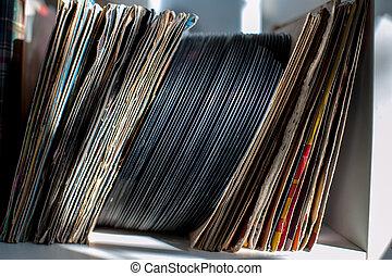 Vintage 45s vynil row on house shelf selective focus