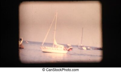 Vintage 8mm. Boats at port entrance