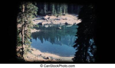 Vintage 8mm. Calm mirroring lake