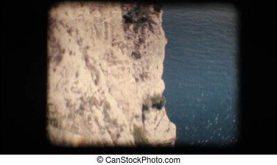 Vintage 8mm. Cliffs on a lake