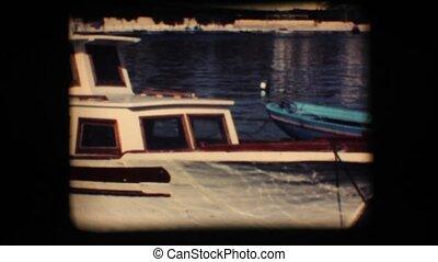 Vintage 8mm. Docked boat