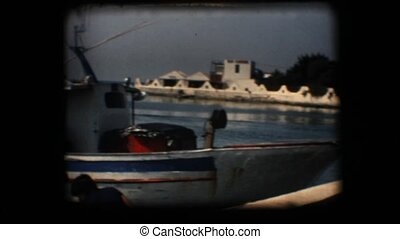 Vintage 8mm. Docked fishing boats