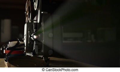Vintage 8mm Film Projector - Front view of an old-fashioned...