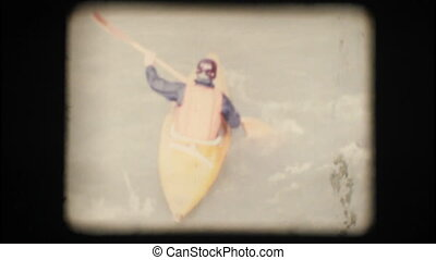 Vintage 8mm. Man kayaking