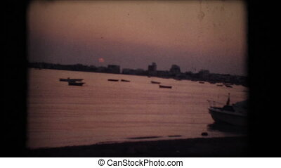 Vintage 8mm. Sunset on a beach in southern Italy