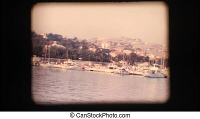 Vintage 8mm. View of port and boats