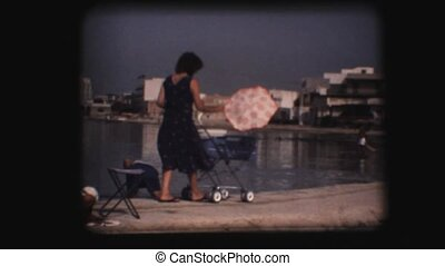 Vintage 8mm. Woman pushing stroller