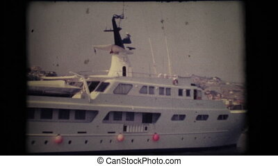 1979. Vintage 8mm. 1960's yacht docked in the port of Sanremo, Italy