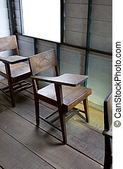 Vintage a school chair with a fold-up tablet/desk made from wood