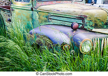 Vintage Abandoned Truck in Field - Close up of abandoned...