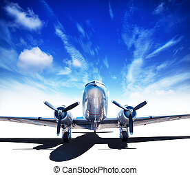 airplane - vintage airplane a against a blue sky