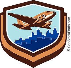 Vintage Airplane Take Off Cityscape Shield Retro