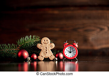 Vintage alarm clock and Christmas tree with cookie