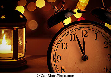 vintage alarm clock is showing midnight. It is twelve...