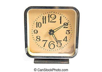 Vintage alarm clock isolated on white