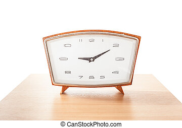 Vintage alarm clock on a wooden table