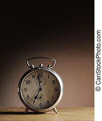 alarm clock - vintage alarm clock on table
