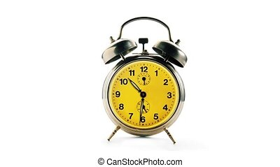Vintage alarm clock over a white background. Time running...