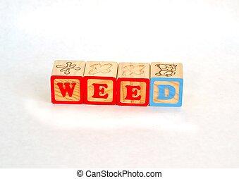 Vintage alphabet blocks spelling out WEED