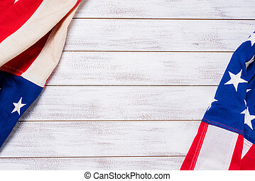 Vintage American flags on a white wooden slat background