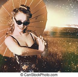 Vintage American pin-up girl in summer rain