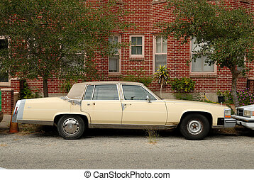 Vintage American sedan parked in front of a house